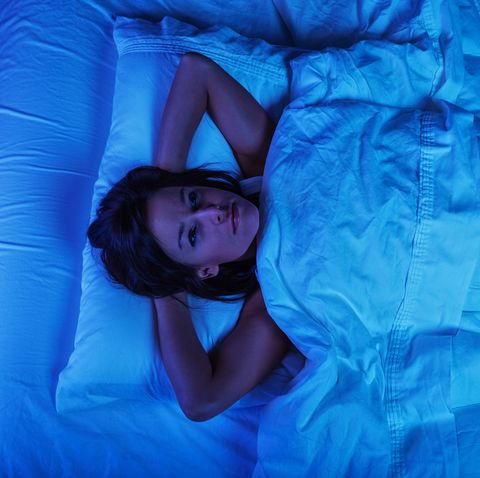 Young Woman in Bed with Insomnia