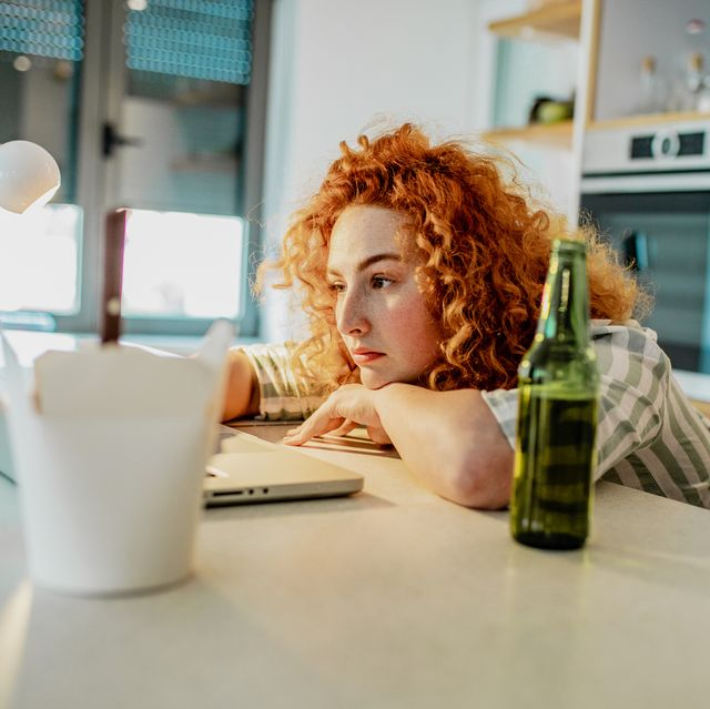 young woman is overworked at home
