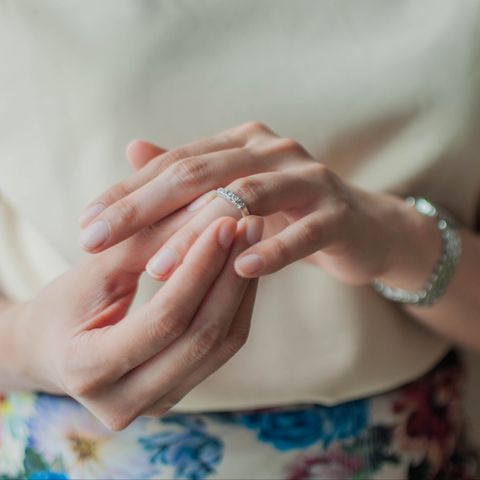 A young woman is wearing her wedding ring