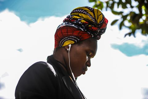 A young woman listening to music on her earphone