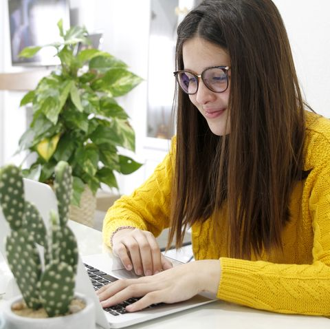young woman making videoconference on laptop