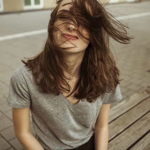 Young woman outdoors with windswept hair