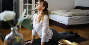 Young woman practice yoga at home