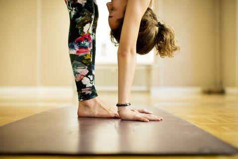 young woman practicing vinyasa yoga