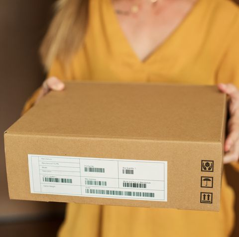 Young woman receiving a package