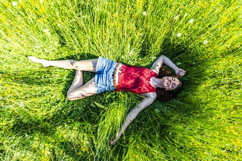Young woman relaxing in meadow