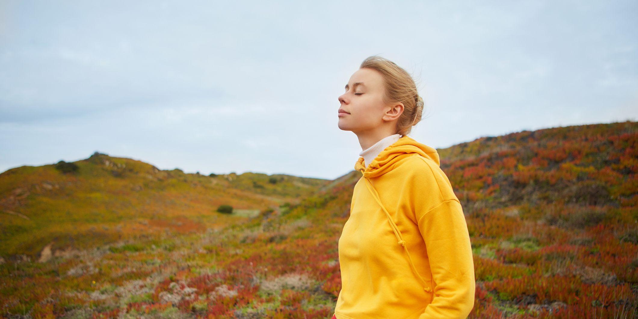 Young woman relaxing near ocean