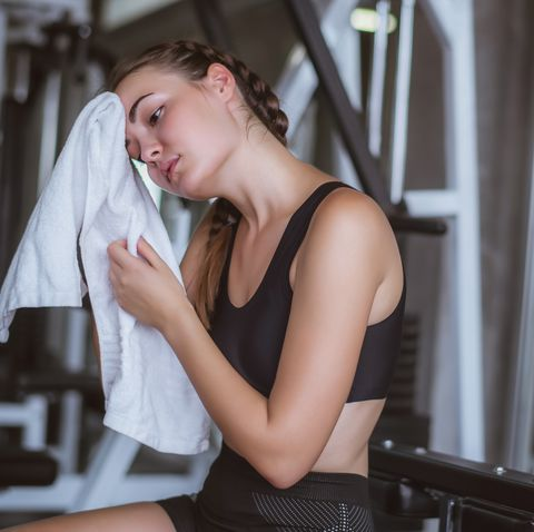 Young Woman Resting At Gym