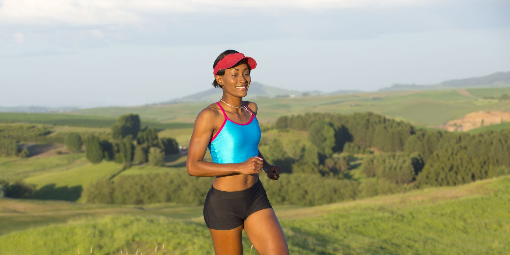 Young woman running in landscape, Othello, Washington, USA