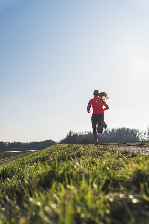 young woman running on rural path