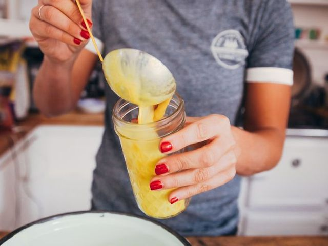 young woman serving golden milk