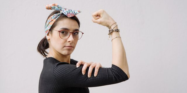 young woman shows her strong arm
