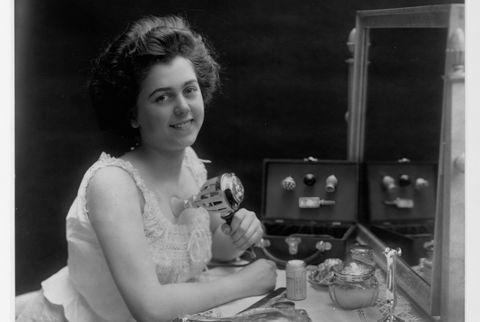 "vintage beauty regimen woman demonstrating ""chest developer"""