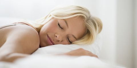 Young woman sleeping, Jersey City, New Jersey, USA