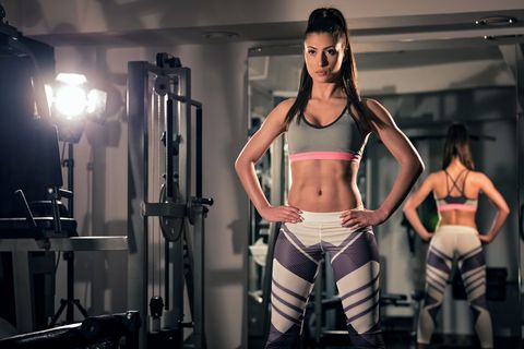 Young woman standing in gym