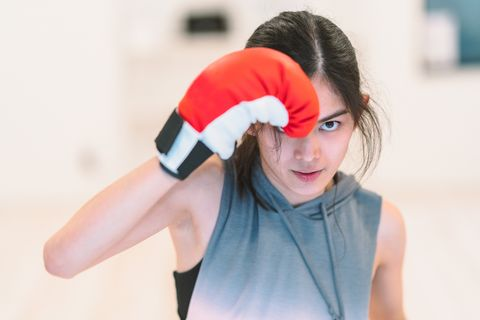 young woman training boxing