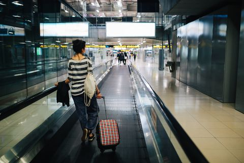 young woman traveling solo arrives on the bangkok airport