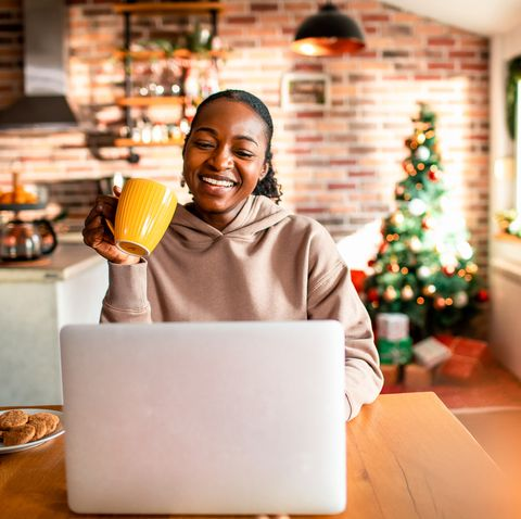 young woman using a laptop during christmas