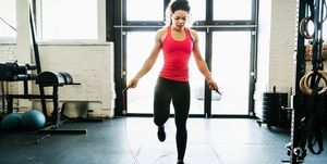 Young Woman Using Skipping Rope To Keep Fit