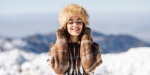 Young Woman With Eyes Closed Standing Outdoors During Winter