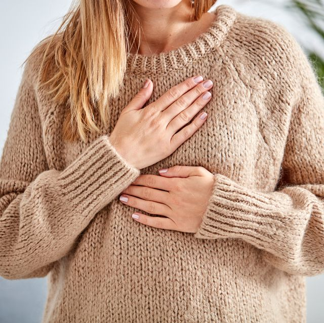 young woman with heart problem holding chest