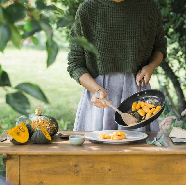 young woman with homemade pumpkin gnocchi, partial view