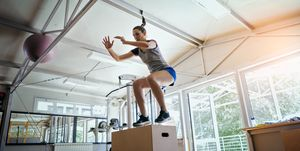 Young woman working out jumping