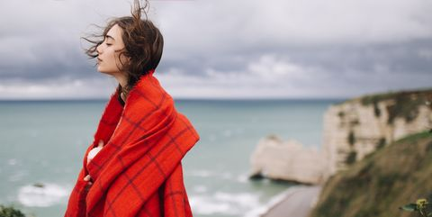 Young woman wrapping in big wool scarf
