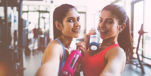 Young women taking selfies at gym after workout