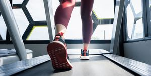 Young women walking and running in the treadmill at the gym