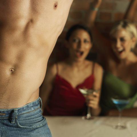 Young Women Watching Male Stripper