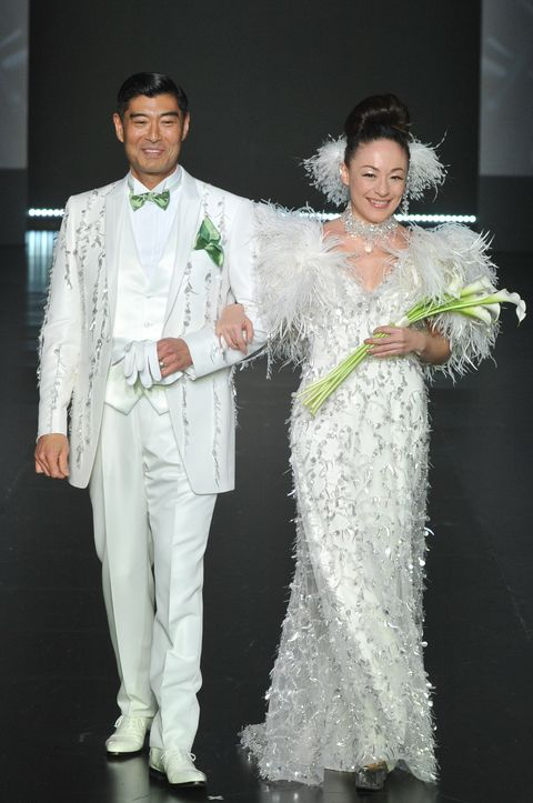 White, Formal wear, Suit, Fashion, Wedding dress, Dress, Bridal clothing, Event, Marriage, Gown,