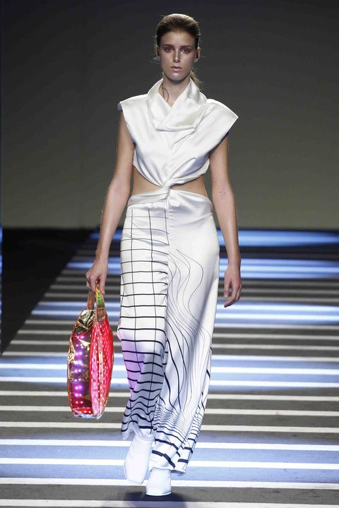 Fashion model, Fashion, Fashion show, Clothing, White, Runway, Shoulder, Fashion design, Beauty, Dress,
