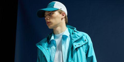Blue, Human, Headgear, Outerwear, Cap, Jacket, Hat, Electric blue, Performance, T-shirt,