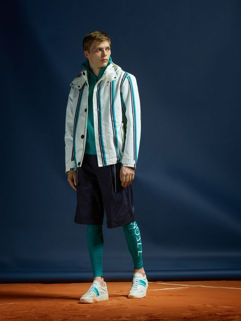 Blue, Fashion, Footwear, Human, Outerwear, Performance, Fashion design, Jacket, Shoe, Electric blue,