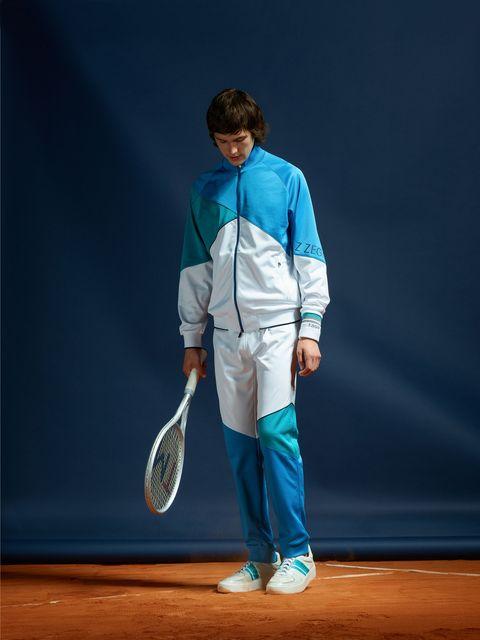 Racquet sport, Outerwear, Tennis, Racket, Tennis player, Jacket, Sports, Performance,