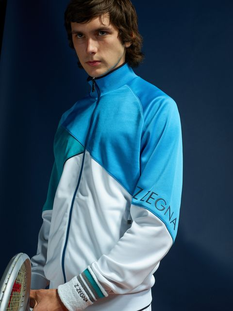 Clothing, Blue, Turquoise, Fencing, Collar, Sleeve, Sportswear, Dress shirt, Outerwear, Jersey,