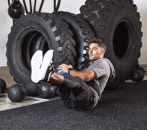 Tire, Automotive tire, Weights, Physical fitness, Wheel, Exercise equipment, Crossfit, Automotive wheel system, Rim, Kettlebell,