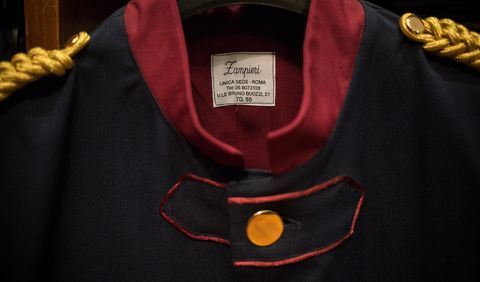 Clothing, Red, Yellow, Sleeve, Outerwear, Collar, T-shirt, Textile, Uniform, Fashion accessory,