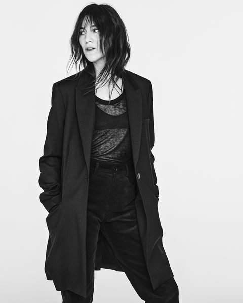 charlotte gainsbourg wears denim and a trench coat from her new denim collection for zara