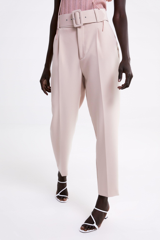 pantalones negro con rosas zara