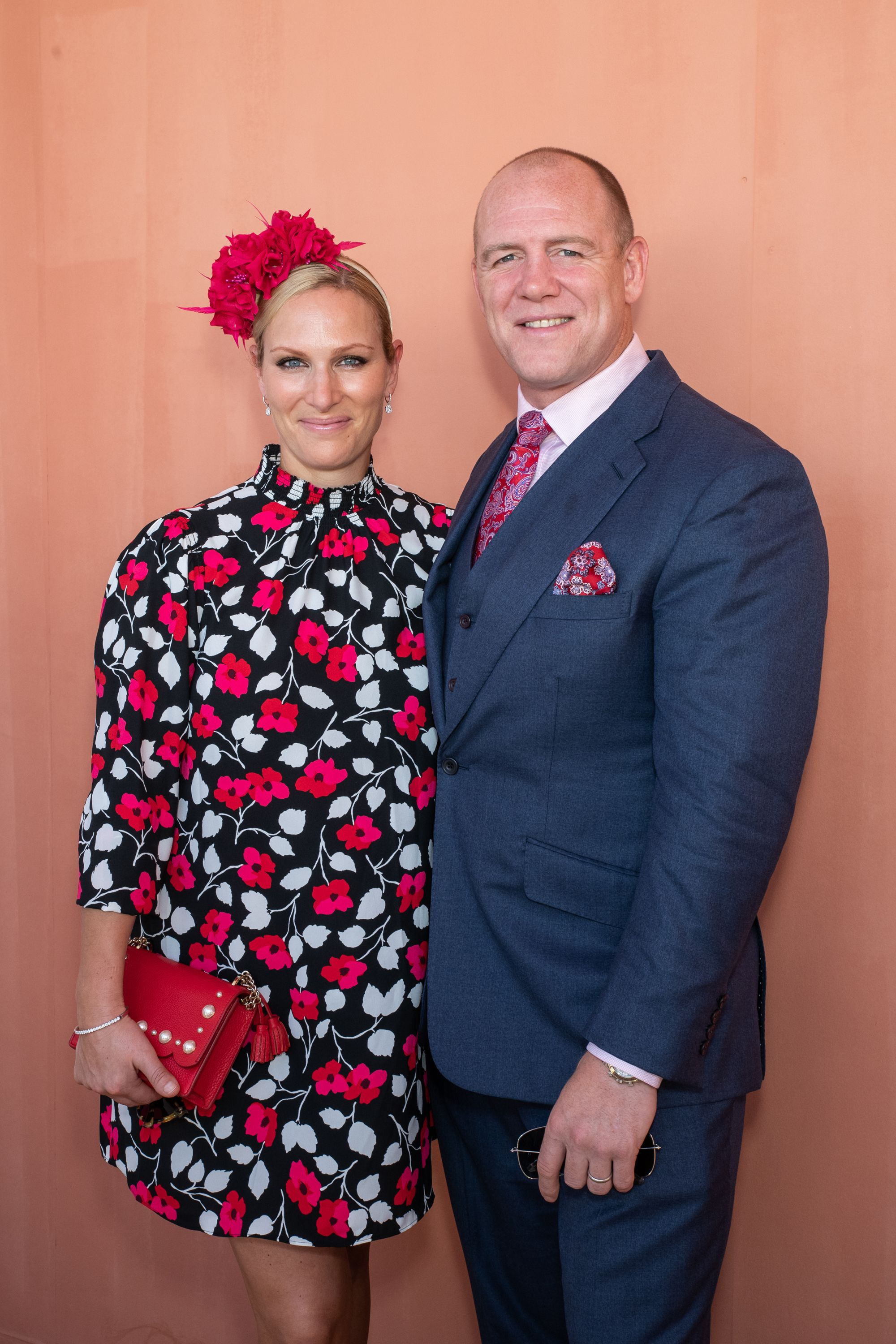 Zara Tindall chose a bright and colorful look as she attended the Magic Millions races with her husband, Mike Tindall, in Gold Coast, Australia. The former equestrian paired a floral mini dress with a fuchsia fascinator by milliner Meg Rafter , and matching clutch by Kate Spade .