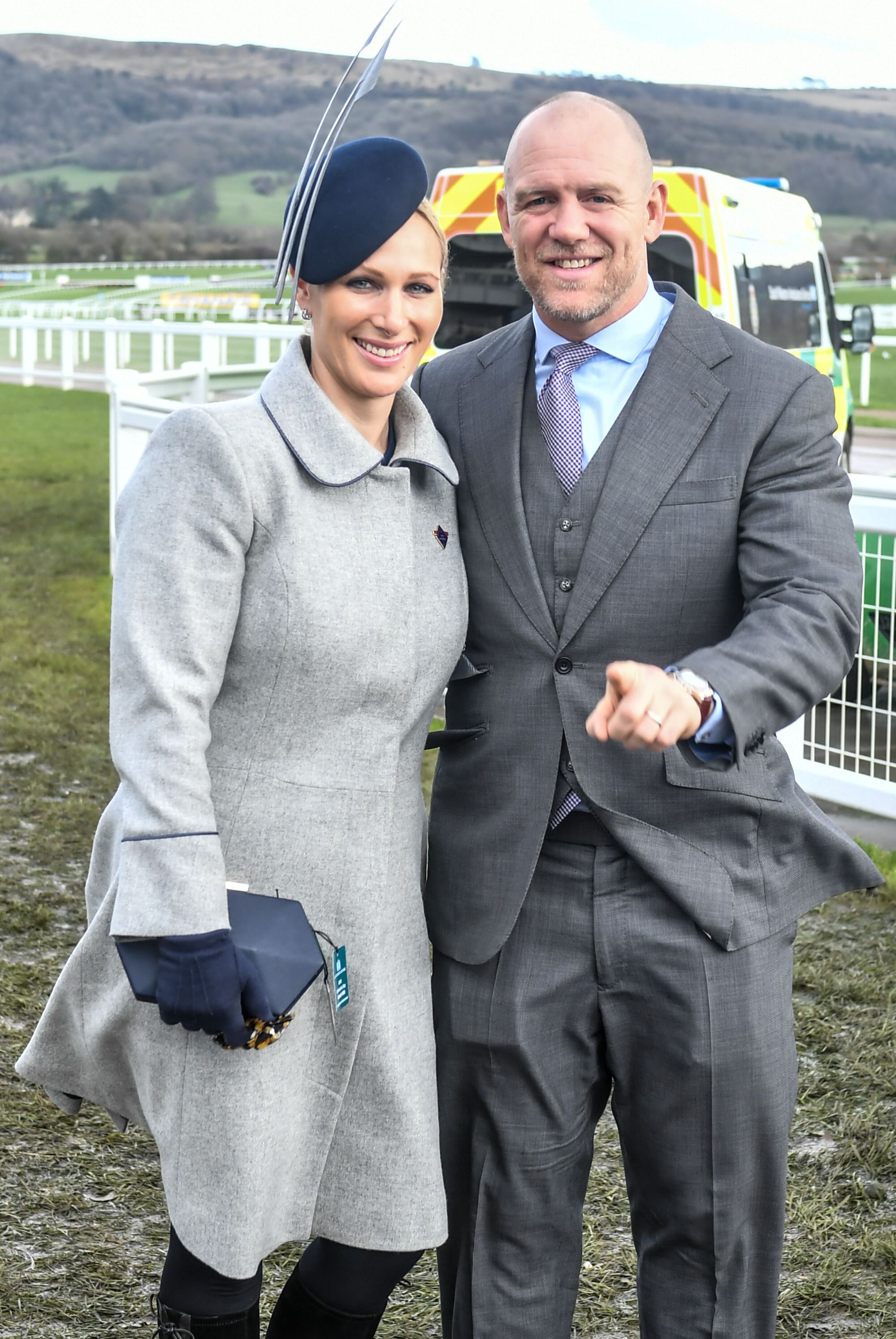 Zara opted for a grey high-neck coat with a navy prism clutch and cocktail hat for a third day at the Cheltenham races.