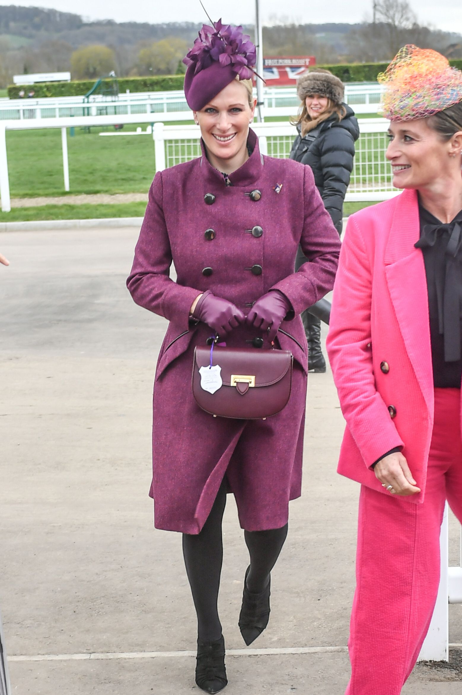 For day 2 of the Cheltenham races, Zara matched her eggplant cocktail hat to a bespoke coat by Pip Howeson and an Aspinal of London saddlebag. Shop Now Letterbox Saddle Bag, Aspinal of London, $650