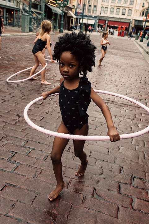 Hula hoop, Toy, Child, Performing arts, Fun, Architecture, Smile, Photography, Dance, Play,