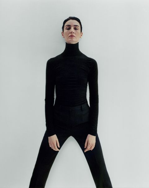 Clothing, Black, Neck, Shoulder, Standing, Sleeve, Fashion, Tights, Joint, Sportswear,