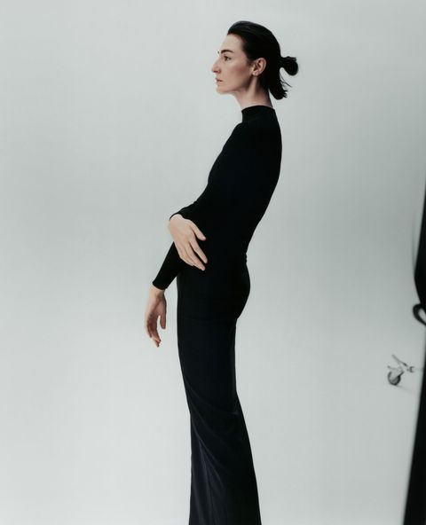 Clothing, Shoulder, Black, Dress, Neck, Standing, Joint, Formal wear, Fashion, Sleeve,