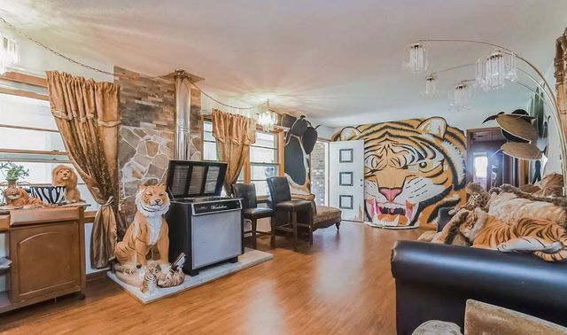 a tiger king esque room, as seen in a house featured on zillowgonewild's instagram account