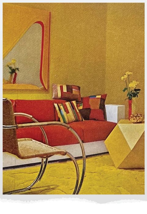 yellow living room with red sofa