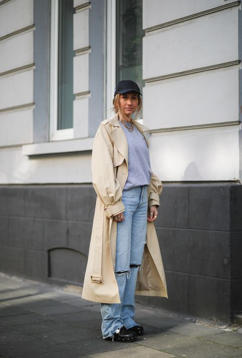 cologne, germany   march 25 michi brandl wearing grey la marel sweater, zara blue jeans, beige edited trenchcoat, scholl iconic clogs and prada cap on march 25, 2021 in cologne, germany photo by jeremy moellergetty images